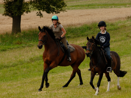 Mum and daughter canter